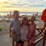 Tara Starkovich with kids on beach